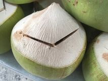 Fresh Coconuts Slightly Cut Open Lid. Ready for Drink Royalty Free Stock Images