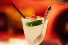 Fresh coctail with lime Stock Images