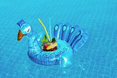 Fresh Coctail Mojito On Inflatable Blue Peacock Toy At Swimming Pool. Vacation Concept Stock Photography