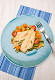 Fresh cod on bed of mixed vegetables Royalty Free Stock Photo