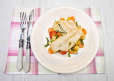 Fresh cod on bed of mixed vegetables Royalty Free Stock Photos