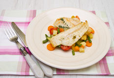 Fresh cod on bed of mixed vegetables Stock Images