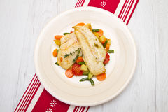 Fresh cod on bed of mixed vegetables Royalty Free Stock Images
