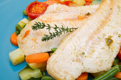 Fresh cod on bed of mixed vegetables Royalty Free Stock Image