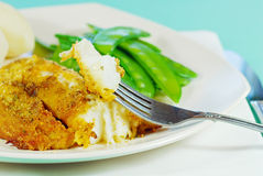 Fresh cod on a fork ready to eat Stock Photo