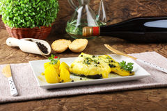 Fresh cod with potatoes and saffron Royalty Free Stock Photo