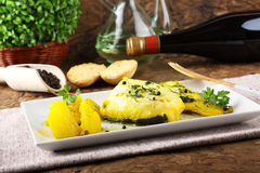 Fresh cod with potatoes and saffron Royalty Free Stock Images