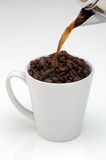 Fresh Coffee. Concept design of pouring a cup of freshly ground coffee Royalty Free Stock Photos