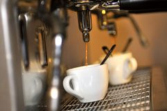 Fresh coffee. Leacking from coffee machine Royalty Free Stock Photography