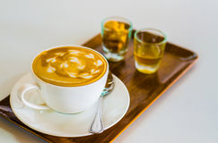Fresh Coffee with Bay Bakery on wooden table. Stock Photography