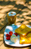 Fresh Coffee with Bay Bakery on wooden table. Royalty Free Stock Images