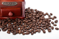 Fresh Coffee Bean And Coffee Bean Grinder Closeup Stock Photos