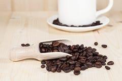 Fresh coffee bean on wood Royalty Free Stock Photos