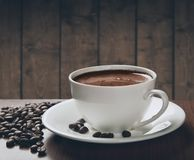 Fresh coffee. With coffee beans Stock Images