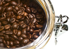 Fresh coffee beans in airtight. Container Stock Images