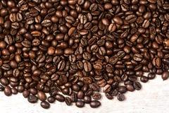 Fresh Coffee beans background macro. Dark Roasted coffee beans t Stock Image