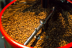 Fresh coffee beans being roasted in a store Stock Image