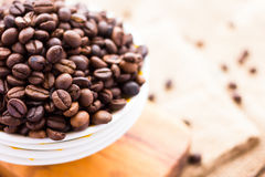 Fresh Coffee Beans. A bowl full of fresh and real coffee beans. Coffee beans in a bowl stock photography Royalty Free Stock Image