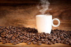 Fresh coffee beans with a cup Royalty Free Stock Photo