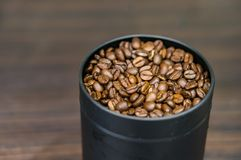 Fresh coffee beans. In a metal container in soft focus Royalty Free Stock Photo