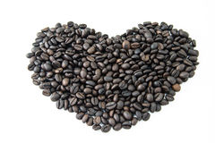 Fresh coffee beans. Heart shaped on white background Stock Photos