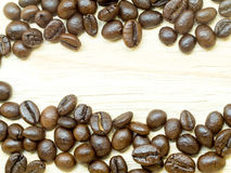 Fresh Coffee beans isolated. On Light wood floor Royalty Free Stock Image