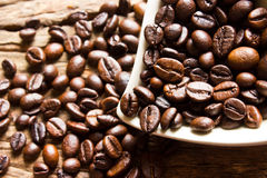 Fresh coffee beans in white heart cup Royalty Free Stock Photo