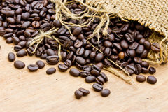Fresh coffee beans on wood background Royalty Free Stock Photos
