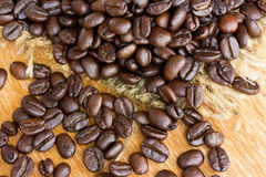 Fresh coffee beans on wood Stock Photos