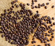 Fresh coffee beans on wood Royalty Free Stock Photography