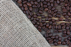 Fresh coffee beans on wood background Royalty Free Stock Images