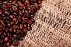 Fresh coffee beans on wood background Stock Photography