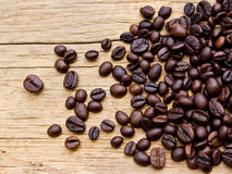 Fresh coffee beans on wood Stock Photo