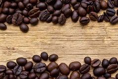 Fresh coffee beans on wood Stock Photography