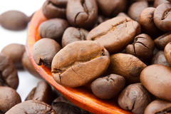 Fresh coffee beans with wooden spoon Royalty Free Stock Image