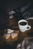 Fresh coffee and biscuits on a wooden tray standing on the bed Stock Photography