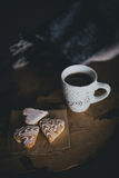 Fresh coffee and biscuits on a wooden tray standing on the bed Stock Photo