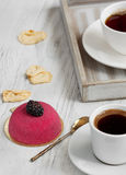 Fresh coffee for breakfast with cake and fresh berries. Mousse cake with berries and a cup of coffee for breakfast Stock Images