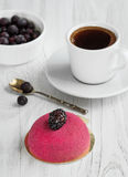 Fresh coffee for breakfast with a cake of marzipan and berries. Mousse cake with berries and a cup of coffee for breakfast Stock Photography