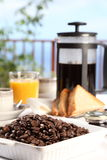 Fresh coffee at breakfast table on a sunny morning Stock Images
