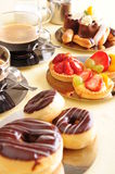 Fresh coffee and cake. Freshly brewed coffee with a selection of cakes and confectionery royalty free stock images