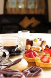 Fresh coffee and cake. Freshly brewed coffee with a selection of cakes and confectionery royalty free stock photography