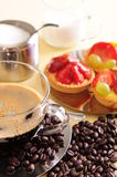 Fresh coffee and cake. Freshly brewed coffee with a selection of cakes and confectionery stock photo