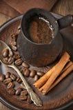 Fresh coffee in cezve Stock Photos