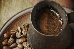 Fresh coffee in cezve Royalty Free Stock Images
