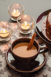 Fresh coffee and cinnamon with candlelight. Royalty Free Stock Images