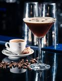 Fresh coffee cocktail with coffee beans and espresso at the bar stock images