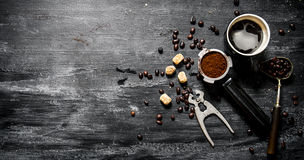 Fresh coffee. Coffee cup with brown sugar and roasted grains . Royalty Free Stock Photo