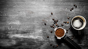Fresh coffee. Coffee cup with roasted grains . Stock Image