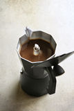 Fresh coffee in a coffee pot Stock Images